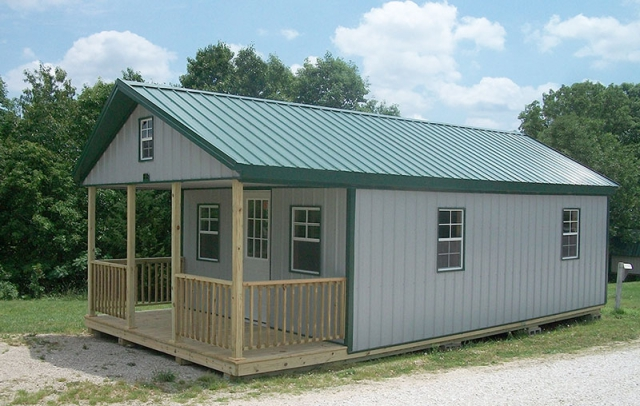 16x32 Hi wall cabin, grey sides, gallery blue roof & trim.