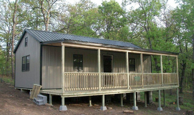 16x32 Deluxe cabin with optional side porch, clay sides, black roof & trim.