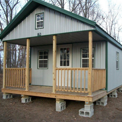 16x32 Deluxe cabin, grey sides, evergreen roof & trim.